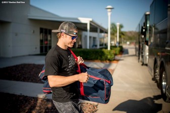 FT. MYERS, FL - FEBRUARY 26: Brock Holt #12 of the Boston Red Sox boards the bus before a spring training game against the Tampa Bay Rays on February 26, 2017 at Fenway South in Fort Myers, Florida . (Photo by Billie Weiss/Boston Red Sox/Getty Images) *** Local Caption *** Brock Holt