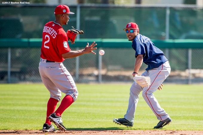 FT. MYERS, FL - FEBRUARY 26: Mookie Betts #50 of the Boston Red Sox flips a ball to Xander Bogaerts #2 during a team workout on February 26, 2017 at Fenway South in Fort Myers, Florida . (Photo by Billie Weiss/Boston Red Sox/Getty Images) *** Local Caption *** Mookie Betts; Xander Bogaerts