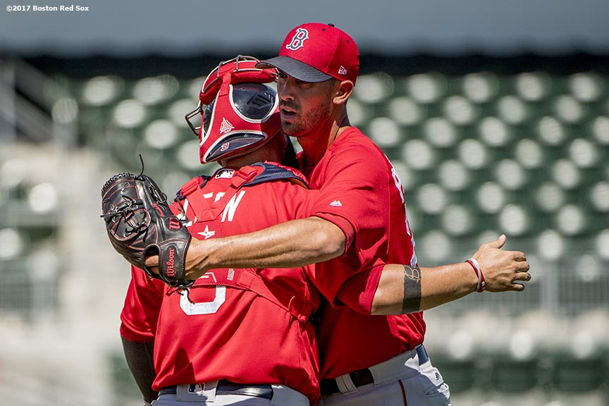 FT. MYERS, FL - FEBRUARY 26: Rick Porcello #22 of the Boston Red Sox hugs Sandy Leon #3 after pitching in a simulated game during a team workout on February 26, 2017 at Fenway South in Fort Myers, Florida . (Photo by Billie Weiss/Boston Red Sox/Getty Images) *** Local Caption *** Rick Porcello; Sandy Leon