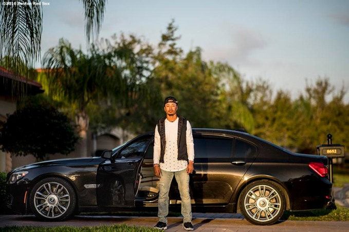 FT. MYERS, FL - MARCH 2: Mookie Betts #50 of the Boston Red Sox poses for a photograph with his car parked outside of his house before driving to jetBlue Park for a Spring Training game against the Tampa Bay Rays on March 2, 2017 at Fenway South in Fort Myers, Florida . (Photo by Billie Weiss/Boston Red Sox/Getty Images) *** Local Caption *** Mookie Betts