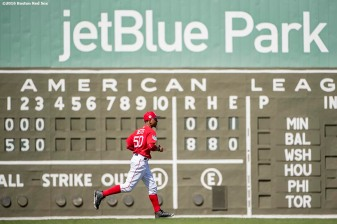FT. MYERS, FL - MARCH 2: Mookie Betts #50 of the Boston Red Sox runs toward right field during the fourth inning of a Spring Training game against the Tampa Bay Rays on March 2, 2017 at Fenway South in Fort Myers, Florida . (Photo by Billie Weiss/Boston Red Sox/Getty Images) *** Local Caption *** Mookie Betts