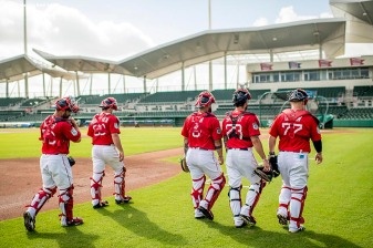 FT. MYERS, FL - MARCH 2: Boston Red Sox catchers walk onto the field before a Spring Training game against the Tampa Bay Rays on March 2, 2017 at Fenway South in Fort Myers, Florida . (Photo by Billie Weiss/Boston Red Sox/Getty Images) *** Local Caption ***