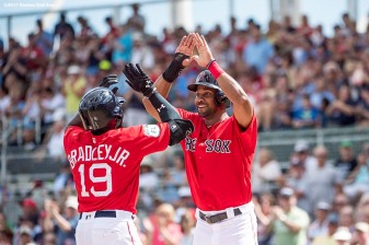 FT. MYERS, FL - MARCH 2: Jackie Bradley Jr. #19 of the Boston Red Sox high fives Chris Young #30 after hitting a solo home run during the first inning of a Spring Training game against the Tampa Bay Rays on March 2, 2017 at Fenway South in Fort Myers, Florida . (Photo by Billie Weiss/Boston Red Sox/Getty Images) *** Local Caption *** Jackie Bradley Jr.; Chris Young