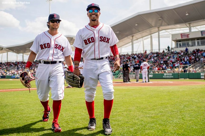 FT. MYERS, FL - MARCH 5: Andrew Benintendi #16 and Mookie Betts #50 of the Boston Red Sox react before a Spring Training game against the Atlanta Braves on March 5, 2017 at Fenway South in Fort Myers, Florida . (Photo by Billie Weiss/Boston Red Sox/Getty Images) *** Local Caption *** Mookie Betts; Andrew Benintendi