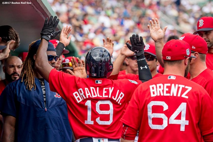 FT. MYERS, FL - MARCH 9: Jackie Bradley Jr. #19 of the Boston Red Sox high fives teammates after hitting a solo home run during the first inning of a Spring Training game against Team USA on March 9, 2017 at Fenway South in Fort Myers, Florida . (Photo by Billie Weiss/Boston Red Sox/Getty Images) *** Local Caption *** Jackie Bradley Jr.;