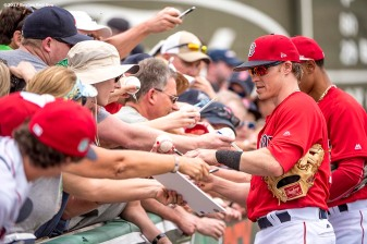 FT. MYERS, FL - MARCH 9: Brock Holt #12 of the Boston Red Sox signs autographs before a Spring Training game against Team USA on March 9, 2017 at Fenway South in Fort Myers, Florida . (Photo by Billie Weiss/Boston Red Sox/Getty Images) *** Local Caption *** Brock Holt
