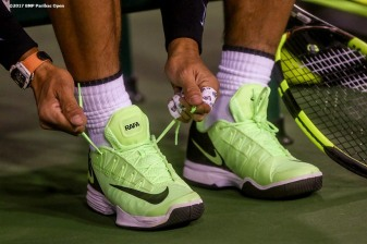 Rafael Nadal ties his shoes before a doubles match with Bernard Tomic against Pablo Carreno Busta and Joao Sousa at the Indian Wells Tennis Garden in Indian Wells, California on Friday, March 10, 2017. (Photo by Billie Weiss/BNP Paribas Open)
