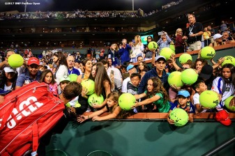 Vasek Pospisil signs autographs after defeating Andy Murray at the Indian Wells Tennis Garden in Indian Wells, California on Saturday, March 11, 2017. (Photo by Billie Weiss/BNP Paribas Open)
