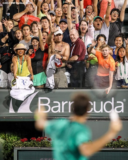 Fans cheer after a match between Roger Federer and Stephane Robert during the 2017 BNP Paribas Open at the Indian Wells Tennis Garden in Indian Wells, California on Sunday, March 12, 2017. (Photo by Billie Weiss/BNP Paribas Open)