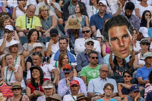 A fan holds a big head during a match between Roger Federer and Rafael Nadal at the Indian Wells Tennis Garden in Indian Wells, California on Saturday, March 11, 2017. (Photo by Billie Weiss/BNP Paribas Open)