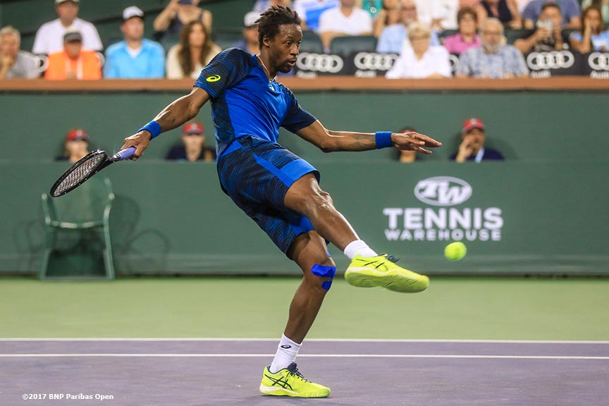 Gael Monfils kicks a tennis ball during a match against Dominic Thiem at the Indian Wells Tennis Garden in Indian Wells, California on Saturday, March 11, 2017. (Photo by Billie Weiss/BNP Paribas Open)