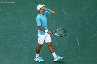 Novak Djokovic reacts during a match against Nick Kyrgios at the Indian Wells Tennis Garden in Indian Wells, California on Saturday, March 11, 2017. (Photo by Billie Weiss/BNP Paribas Open)