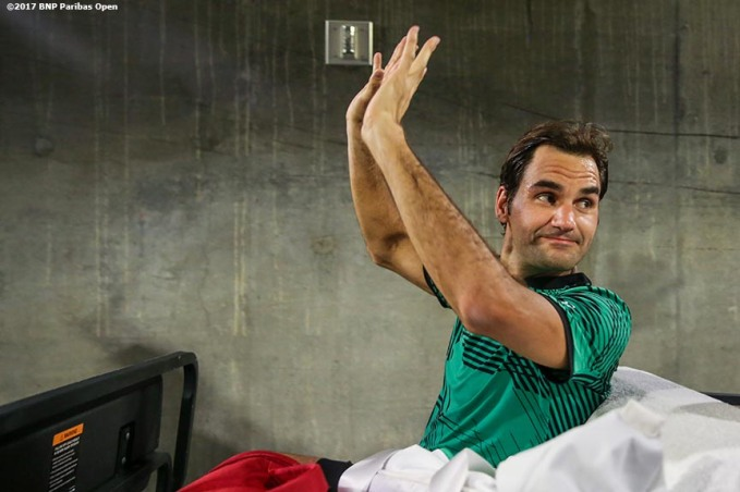 Roger Federer waves as he rides away in the golf cart after defeating Rafael Nadal at the Indian Wells Tennis Garden in Indian Wells, California on Saturday, March 11, 2017. (Photo by Billie Weiss/BNP Paribas Open)