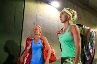 Kristina Mladenovic and Elena Vesnina walk through the tunnel before the semi-final match at the Indian Wells Tennis Garden in Indian Wells, California on Friday, March 17, 2017. (Photo by Billie Weiss/BNP Paribas Open)