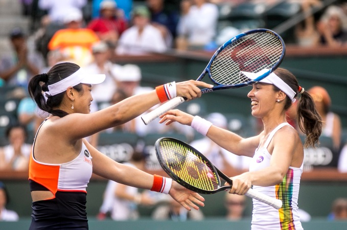 Yung-Jan Chan and Martina Hingis react after winning the women's doubles final against Lucie Hradecka and Katerina Siniakova at the Indian Wells Tennis Garden in Indian Wells, California on Saturday, March 18, 2017. (Photo by Billie Weiss/BNP Paribas Open)