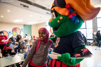 March 27, 2017, Boston, MA: Boston Red Sox mascot Tessie greets students as Red Sox hats are given away during a visit to the Hennigan School in Jamaica Plain, Massachusetts Monday, March 27, 2017. (Photo by Billie Weiss/Boston Red Sox)
