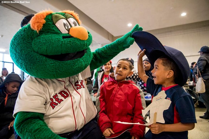 March 27, 2017, Boston, MA: Boston Red Sox mascot Wally the Green Monster greets students as Red Sox hats are given away during a visit to the Hennigan School in Jamaica Plain, Massachusetts Monday, March 27, 2017. (Photo by Billie Weiss/Boston Red Sox)