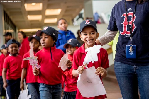 March 27, 2017, Boston, MA: Students react as Red Sox hats are given away during a visit to the Hennigan School in Jamaica Plain, Massachusetts Monday, March 27, 2017. (Photo by Billie Weiss/Boston Red Sox)