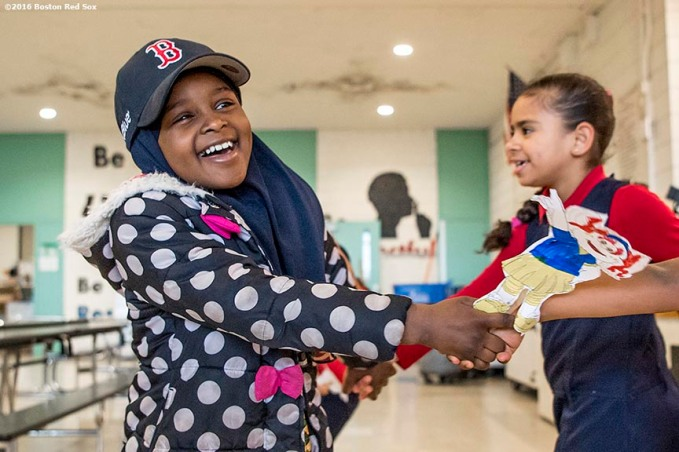 March 27, 2017, Boston, MA: Students dance as Red Sox hats are given away during a visit to the Hennigan School in Jamaica Plain, Massachusetts Monday, March 27, 2017. (Photo by Billie Weiss/Boston Red Sox)