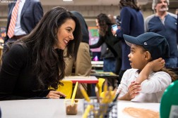March 27, 2017, Boston, MA: Linda Pizzuti Henry, wife of Boston Red Sox Principal Owner John Henry, greets a student as Red Sox hats are given away during a visit to the Hennigan School in Jamaica Plain, Massachusetts Monday, March 27, 2017. (Photo by Billie Weiss/Boston Red Sox)