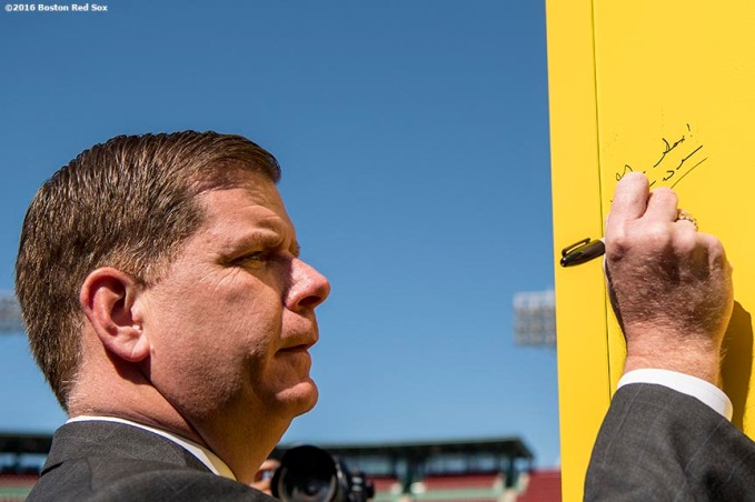 March 30, 2017, Boston, MA: Boston Mayor Marty Walsh signs the Pesky Pole during the Mayor's Walk Through at Fenway Park in Boston, Massachusetts Thursday, March 30, 2017. (Photo by Billie Weiss/Boston Red Sox)