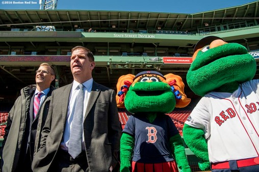 March 30, 2017, Boston, MA: Boston Red Sox President Sam Kennedy and Boston Mayor Marty Walsh look on with Boston Red Sox mascots Tessie and Wally the Green Monster during the Mayor's Walk Through at Fenway Park in Boston, Massachusetts Thursday, March 30, 2017. (Photo by Billie Weiss/Boston Red Sox)
