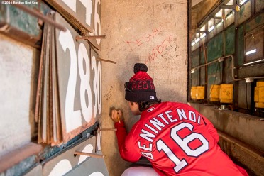 April 2, 2017, Boston, MA: Boston Red Sox left fielder Andrew Benintendi signs the wall as he enters the Green Monster for the first time during a team workout at Fenway Park in Boston, Massachusetts Sunday, April 2, 2017. (Photo by Billie Weiss/Boston Red Sox)