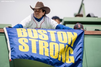 BOSTON, MA - APRIL 3: Boston Marathon bombing hero Carlos Arredondo holds a 'Boston Strong' flag before the Boston Red Sox home opener against the Pittsburgh Pirates on April 3, 2017 at Fenway Park in Boston, Massachusetts. (Photo by Billie Weiss/Boston Red Sox/Getty Images) *** Local Caption *** Carlos Arredondo