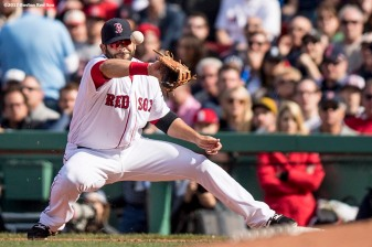 BOSTON, MA - APRIL 3: Mitch Moreland #18 of the Boston Red Sox mishandles a throw during the sixth inning of the home opener against the Pittsburgh Pirates April 3, 2017 at Fenway Park in Boston, Massachusetts. (Photo by Billie Weiss/Boston Red Sox/Getty Images) *** Local Caption *** Mitch Moreland