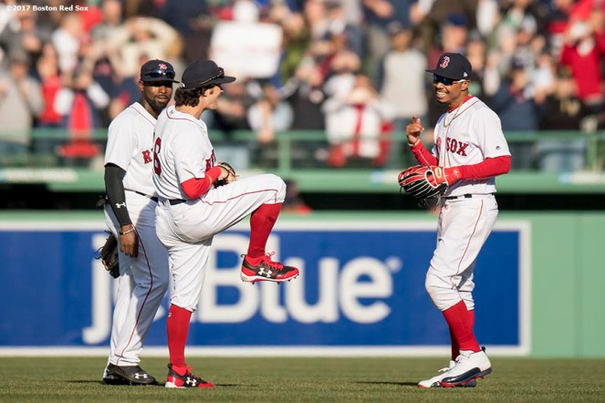 BOSTON, MA - APRIL 3: Andrew Benintendi #16, Jackie Bradley Jr. #19, and Mookie Betts #50 of the Boston Red Sox celebrate a victory during the home opener against the Pittsburgh Pirates April 3, 2017 at Fenway Park in Boston, Massachusetts. (Photo by Billie Weiss/Boston Red Sox/Getty Images) *** Local Caption *** Andrew Benintendi; Jackie Bradley Jr.; Mookie Betts
