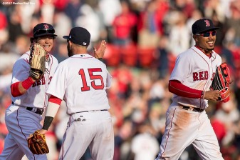 BOSTON, MA - APRIL 3: Andrew Benintendi #16, Dustin Pedroia #15, and Mookie Betts #50 of the Boston Red Sox celebrate a victory during the home opener against the Pittsburgh Pirates April 3, 2017 at Fenway Park in Boston, Massachusetts. (Photo by Billie Weiss/Boston Red Sox/Getty Images) *** Local Caption *** Andrew Benintendi; Dustin Pedroia #15; Mookie Betts