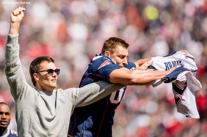BOSTON, MA - APRIL 3: New England Partriots quarterback Tom Brady has his jersey stolen by tight end Rob Gronkowski during a pre-game ceremony before the Boston Red Sox home opener against the Pittsburgh Pirates on April 3, 2017 at Fenway Park in Boston, Massachusetts. (Photo by Billie Weiss/Boston Red Sox/Getty Images) *** Local Caption *** Tom Brady; Rob Gronkowski