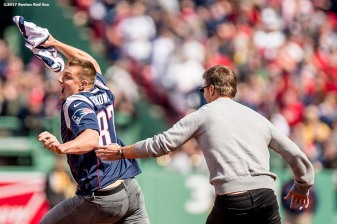 BOSTON, MA - APRIL 3: New England Partriots tight end Rob Gronkowski is chased by quarterback Tom Brady after stealing his jersey during a pre-game ceremony before the Boston Red Sox home opener against the Pittsburgh Pirates on April 3, 2017 at Fenway Park in Boston, Massachusetts. (Photo by Billie Weiss/Boston Red Sox/Getty Images) *** Local Caption *** Tom Brady; Rob Gronkowski