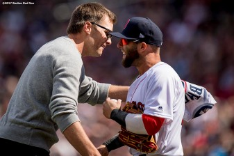 BOSTON, MA - APRIL 3: Tom Brady #12 of the New England Patriots reacts with Dustin Pedroia #15 of the Boston Red Sox after throwing out the ceremonial first pitch during a pre-game ceremony before the Boston Red Sox home opener against the Pittsburgh Pirates on April 3, 2017 at Fenway Park in Boston, Massachusetts. (Photo by Billie Weiss/Boston Red Sox/Getty Images) *** Local Caption *** Tom Brady; Dustin Pedroia