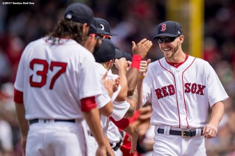 BOSTON, MA - APRIL 3: Chris Sale #41 of the Boston Red Sox high fives teammates as he is introduced before the home opener against the Pittsburgh Pirates April 3, 2017 at Fenway Park in Boston, Massachusetts. (Photo by Billie Weiss/Boston Red Sox/Getty Images) *** Local Caption *** Chris Sale