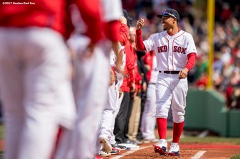 BOSTON, MA - APRIL 3: Mookie Betts #50 of the Boston Red Sox high fives teammates as he is introduced before the home opener against the Pittsburgh Pirates April 3, 2017 at Fenway Park in Boston, Massachusetts. (Photo by Billie Weiss/Boston Red Sox/Getty Images) *** Local Caption *** Mookie Betts