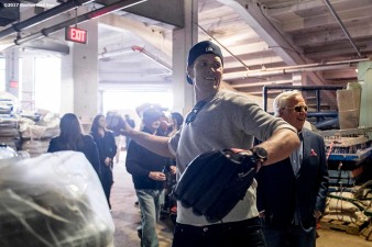 BOSTON, MA - APRIL 3: Tom Brady #12 of the New England Patriots warms up alongside owner Robert Kraft before throwing the ceremonial first pitch during a pre-game ceremony before the Boston Red Sox home opener against the Pittsburgh Pirates on April 3, 2017 at Fenway Park in Boston, Massachusetts. (Photo by Billie Weiss/Boston Red Sox/Getty Images) *** Local Caption *** Tom Brady; Robert Kraft