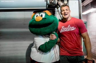 BOSTON, MA - APRIL 3: Rob Gronkowski #87 of the New England Patriots is greeted by Boston Red Sox mascot Wally before a pre-game ceremony before the Boston Red Sox home opener against the Pittsburgh Pirates on April 3, 2017 at Fenway Park in Boston, Massachusetts. (Photo by Billie Weiss/Boston Red Sox/Getty Images) *** Local Caption *** Rob Gronkowski; Wally