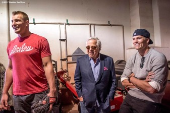 BOSTON, MA - APRIL 3: Rob Gronkowski #87, owner Robert Kraft, and Tom Brady #12 of the New England Patriots react below the stadium before a pre-game ceremony before the Boston Red Sox home opener against the Pittsburgh Pirates on April 3, 2017 at Fenway Park in Boston, Massachusetts. (Photo by Billie Weiss/Boston Red Sox/Getty Images) *** Local Caption *** Tom Brady; Rob Gronkowski; Robert Kraft