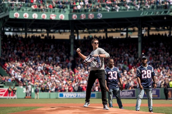 BOSTON, MA - APRIL 3: Tom Brady #12 of the New England Patriots throws out the ceremonial first pitch during a pre-game ceremony before the Boston Red Sox home opener against the Pittsburgh Pirates on April 3, 2017 at Fenway Park in Boston, Massachusetts. (Photo by Billie Weiss/Boston Red Sox/Getty Images) *** Local Caption *** Tom Brady