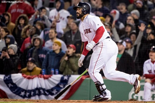 BOSTON, MA - APRIL 5: Sandy Leon #3 of the Boston Red Sox hits a walk off three run home run during the twelfth inning of a game against the Pittsburgh Pirates on April 5, 2017 at Fenway Park in Boston, Massachusetts. (Photo by Billie Weiss/Boston Red Sox/Getty Images) *** Local Caption ***Sandy Leon