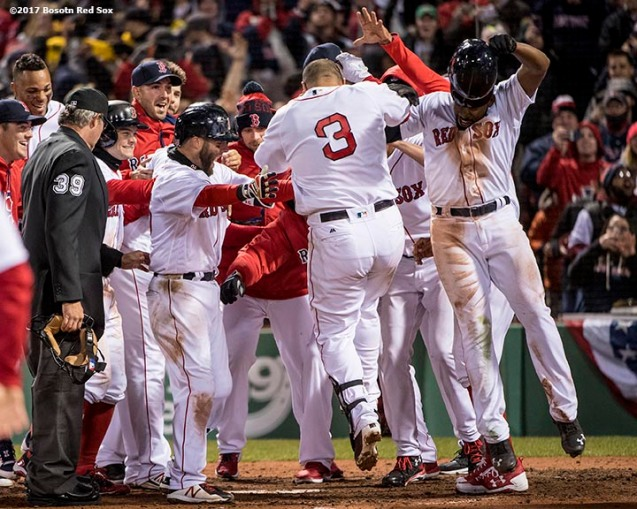 BOSTON, MA - APRIL 5: Sandy Leon #3 of the Boston Red Sox is mobbed by teammates after hitting a walk off three run home run during the twelfth inning of a game against the Pittsburgh Pirates on April 5, 2017 at Fenway Park in Boston, Massachusetts. (Photo by Billie Weiss/Boston Red Sox/Getty Images) *** Local Caption ***Sandy Leon