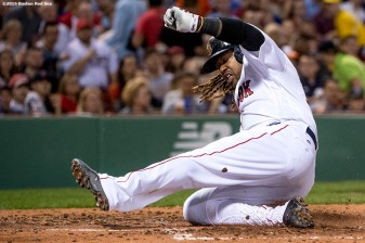 BOSTON, MA - APRIL 11: Hanley Ramirez #13 of the Boston Red Sox slides as he scores during the second inning of a game against the Baltimore Orioles on April 11, 2017 at Fenway Park in Boston, Massachusetts. (Photo by Billie Weiss/Boston Red Sox/Getty Images) *** Local Caption *** Hanley Ramirez