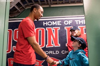 BOSTON, MA - APRIL 12: Mookie Betts #50 of the Boston Red Sox greets a Make A Wish visitor before a game against the Baltimore Orioles April 12, 2017 at Fenway Park in Boston, Massachusetts. (Photo by Billie Weiss/Boston Red Sox/Getty Images) *** Local Caption *** Mookie Betts