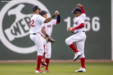 BOSTON, MA - APRIL 15: Chris Young #30, Andrew Benintendi #16, and Mookie Betts #50 of the Boston Red Sox celebrate a victory after defeating the Tampa Bay Rays on April 15, 2017 at Fenway Park in Boston, Massachusetts. (Photo by Billie Weiss/Boston Red Sox/Getty Images) *** Local Caption *** Chris Young; Andrew Benintendi; Mookie Betts