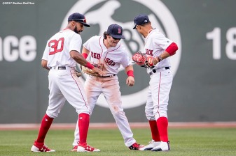 BOSTON, MA - APRIL 16: Chris Young #30, Andrew Benintendi #16, and Mookie Betts #50 of the Boston Red Sox celebrate a victory against the Tampa Bay Rays on April 16, 2017 at Fenway Park in Boston, Massachusetts. (Photo by Billie Weiss/Boston Red Sox/Getty Images) *** Local Caption *** Chris Young; Andrew Benintendi; Mookie Betts