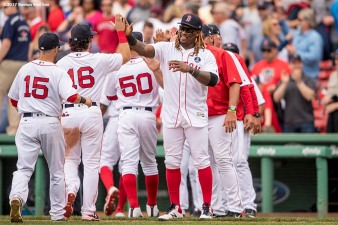 BOSTON, MA - APRIL 17: Hanley Ramirez #13 of the Boston Red Sox high fives teammates as they celebrate a victory against the Tampa Bay Rays on April 17, 2017 at Fenway Park in Boston, Massachusetts. (Photo by Billie Weiss/Boston Red Sox/Getty Images) *** Local Caption *** Hanley Ramirez