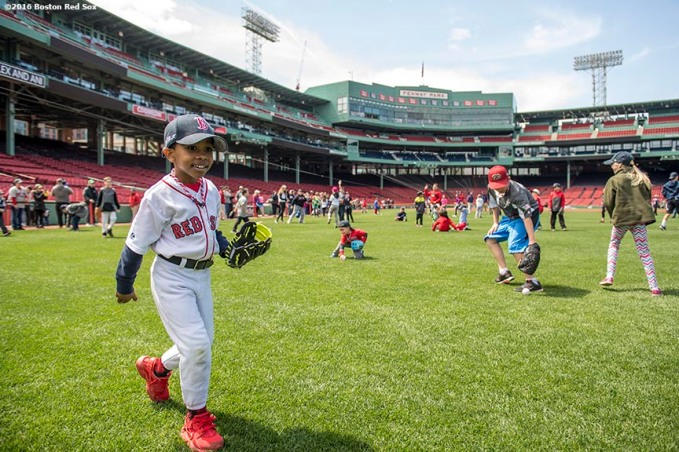April 19, 2017, Boston, MA: A kid plays during Little League Opening Day at Fenway Park in Boston, Massachusetts Wednesday, April 19, 2017. (Photo by Billie Weiss/Boston Red Sox)