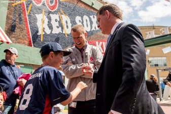 April 19, 2017, Boston, MA: Boston Red Sox president Sam Kennedy and Boston Mayor Marty Walsh greet a young fan during Little League Opening Day at Fenway Park in Boston, Massachusetts Wednesday, April 19, 2017. (Photo by Billie Weiss/Boston Red Sox)