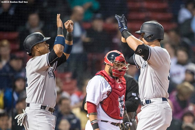 BOSTON, MA - APRIL 26: Aaron Judge #99 of the New York Yankees high fives Starlin Castro #14 after hitting a two run home run during the second inning of a game against the Boston Red Sox on April 26, 2017 at Fenway Park in Boston, Massachusetts. (Photo by Billie Weiss/Boston Red Sox/Getty Images) *** Local Caption *** Aaron Judge; Starlin Castro